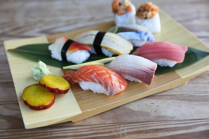 Sushi Set nigiri and sushi rolls on wood background royalty free stock photography