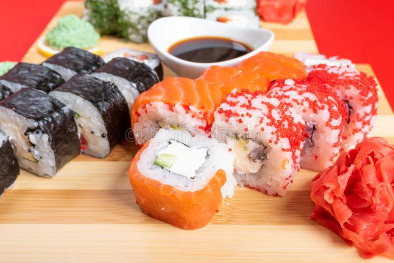 Sushi set of rolls and poppies, with salmon and caviar. Close-up stock photos