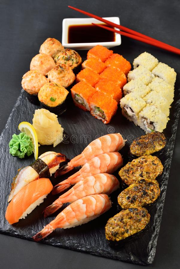 Sushi Set and sushi rolls served on stone plate stock photo