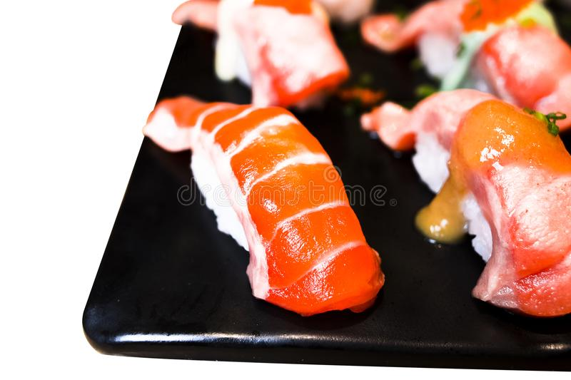 Sushi Set sashimi and sushi rolls served on black stone slate. royalty free stock photos