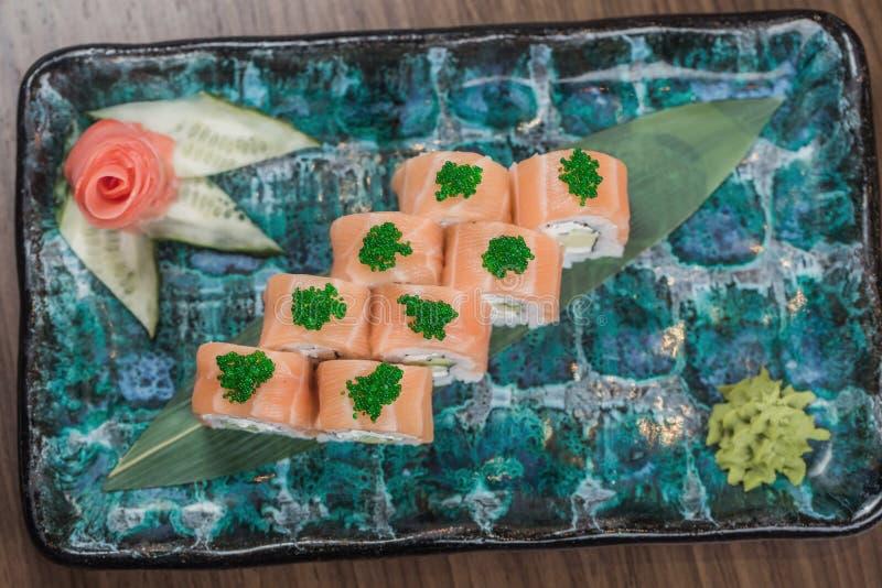 Sushi Set sashimi and sushi rolls served on stone slate royalty free stock image