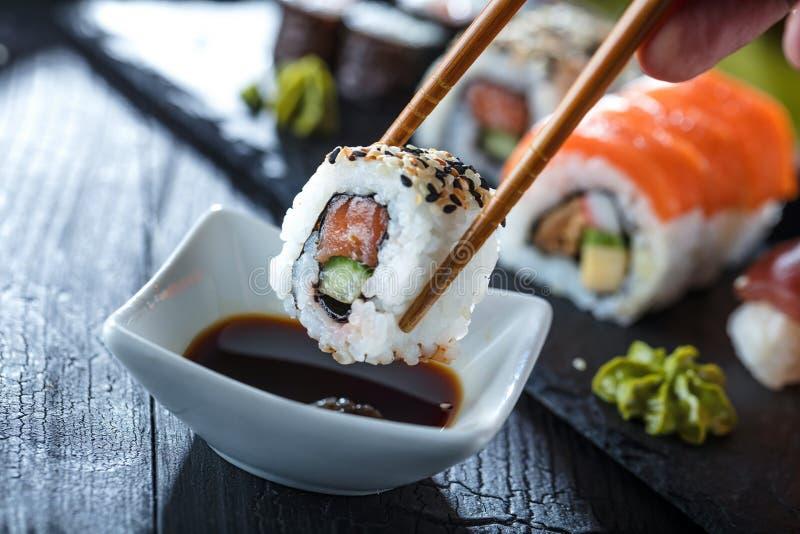 Sushi Set sashimi and sushi rolls served on stone slate. royalty free stock photo