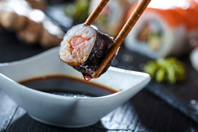 Sushi Set sashimi and sushi rolls served on stone slate. royalty free stock image