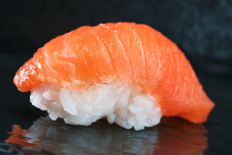Sushi Set sashimi and sushi rolls served on stone slate. royalty free stock images