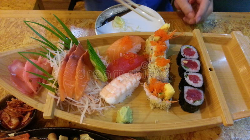 Sushi set on small boat royalty free stock photos