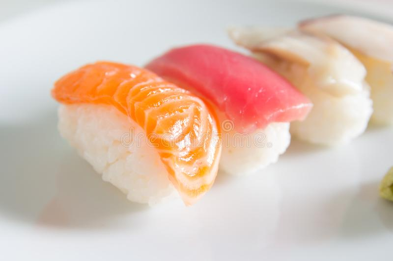Sushi set on white plate. royalty free stock images