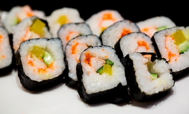Sushi set on white plate with selective focus royalty free stock photo