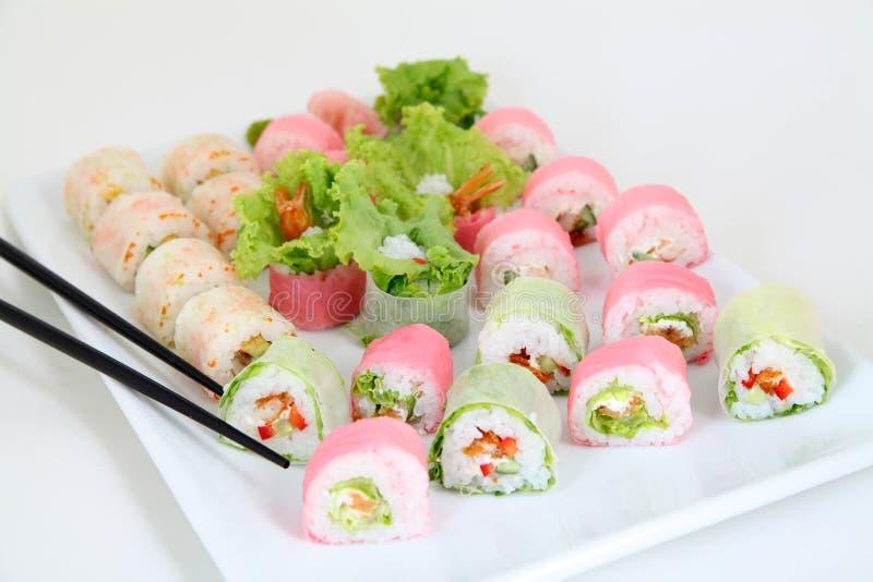 Sushi set on white plate. Traditional japanese sushi rolls stock photos