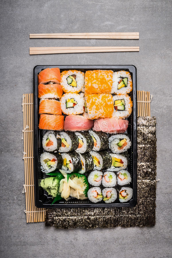 Sushi setting with outside and inside rolls royalty free stock images