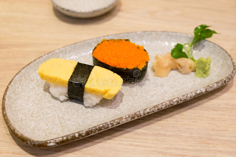 Sushi shrimp eggs and egg sushi tamago sushi royalty free stock image