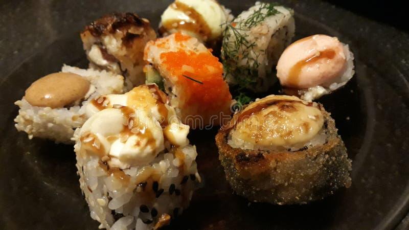 Sushi sortido e rolos imagem de stock royalty free