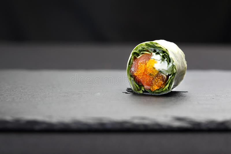 Sushi. Spring rolls, sushi rolls with salmon, rucola, philadelphia cheese. stock images