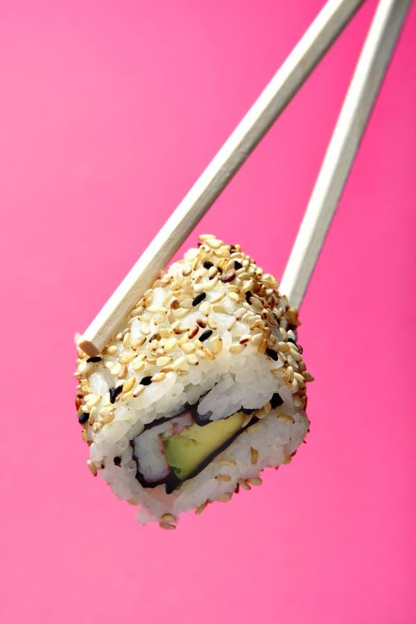 Sushi sulle bacchette fotografia stock