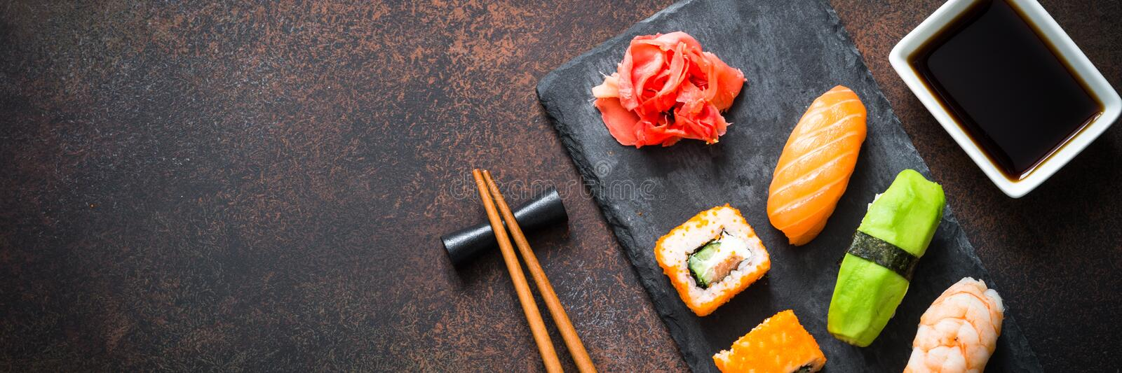 Sushi and sushi roll set on stone table top view royalty free stock photography