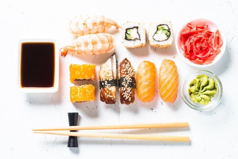 Sushi and sushi roll set on white background. stock images