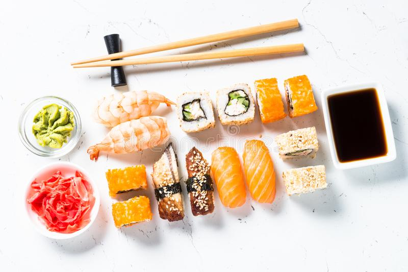 Sushi and sushi roll set on white background. royalty free stock photos