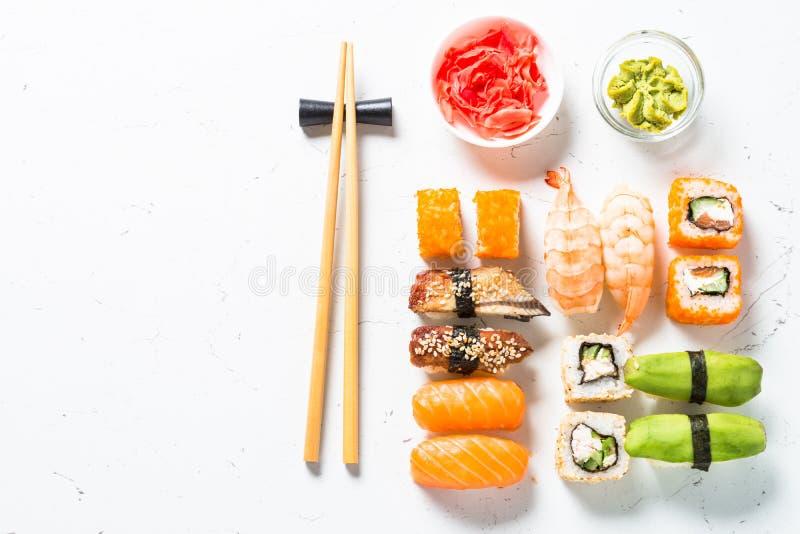 Sushi and sushi roll set on white background. stock photos