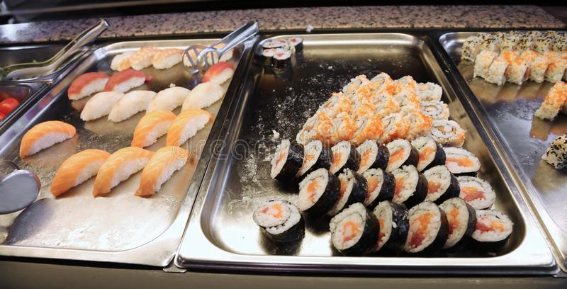 Sushi on the trays of a Japanese restaurant stock photo