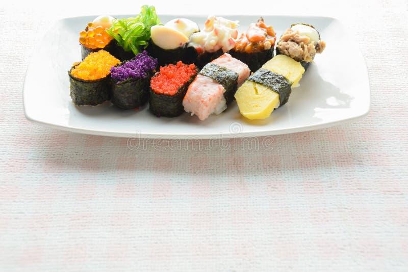 Sushi on white plate, tuna, salmon, sea bass, sweet egg, shrimp sushi. Japanese food royalty free stock photos