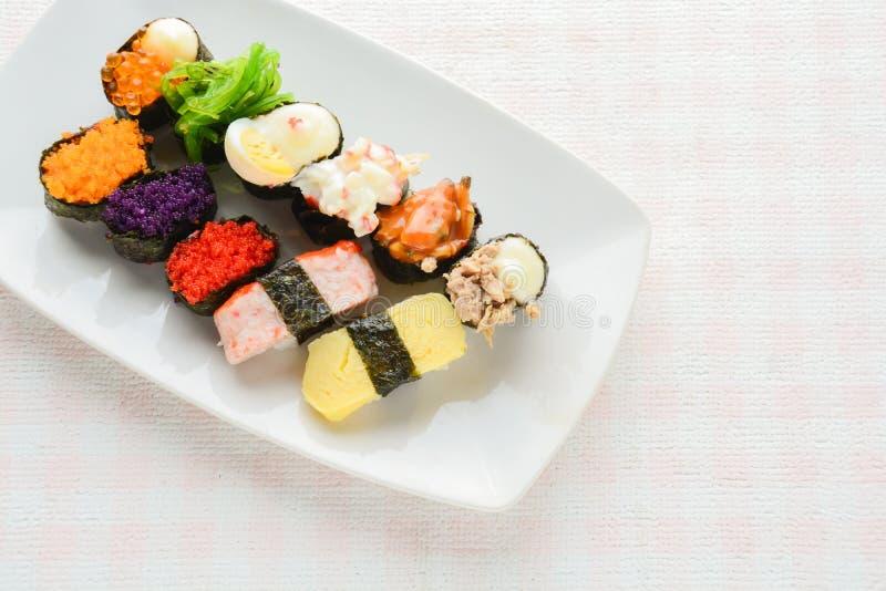 Sushi on white plate, tuna, salmon, sea bass, sweet egg, shrimp sushi. Japanese food royalty free stock photo