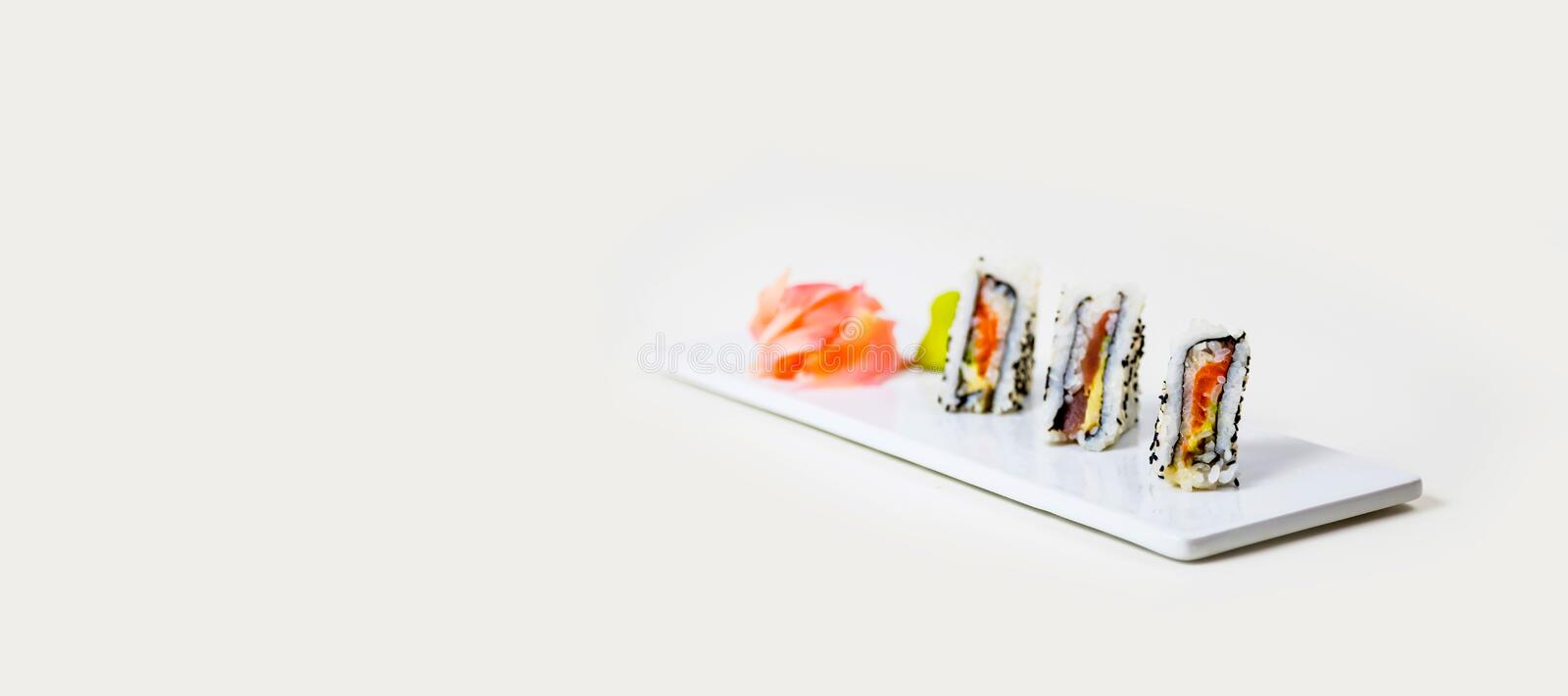 Sushi on a white plate on a white background royalty free stock photos