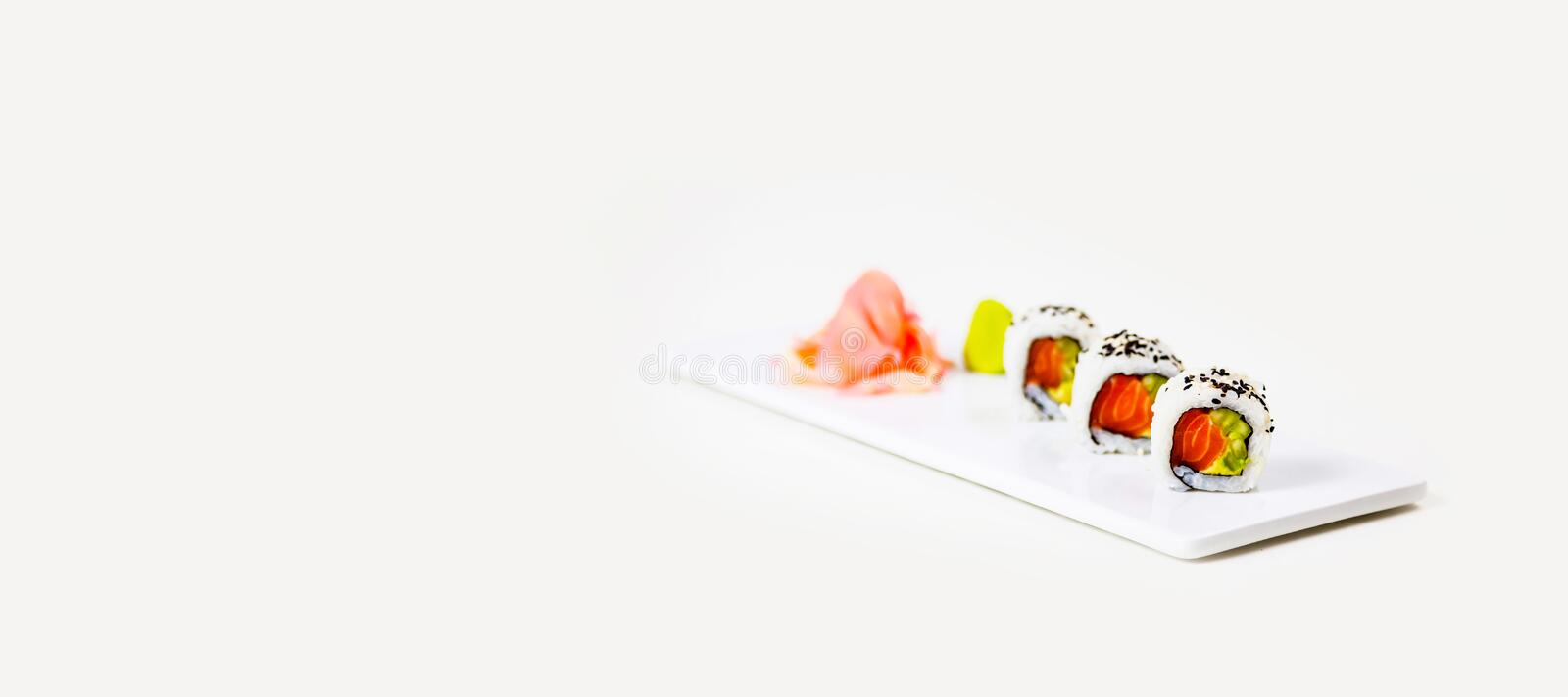 Sushi on a white plate on a white background stock photo