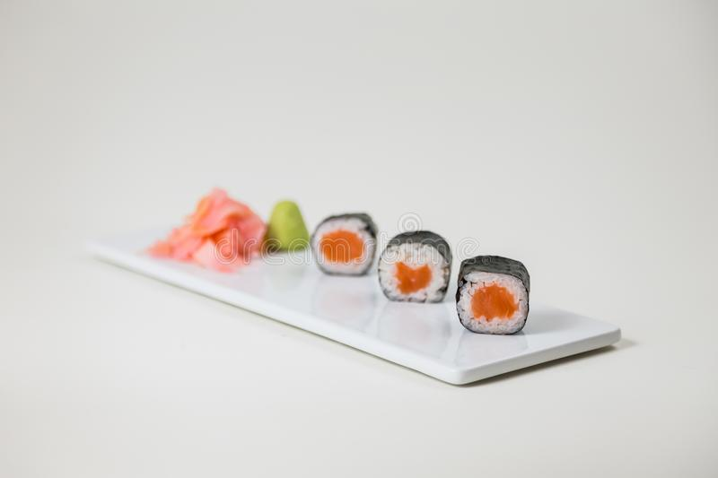Sushi on a white plate on a white background isolated stock photography