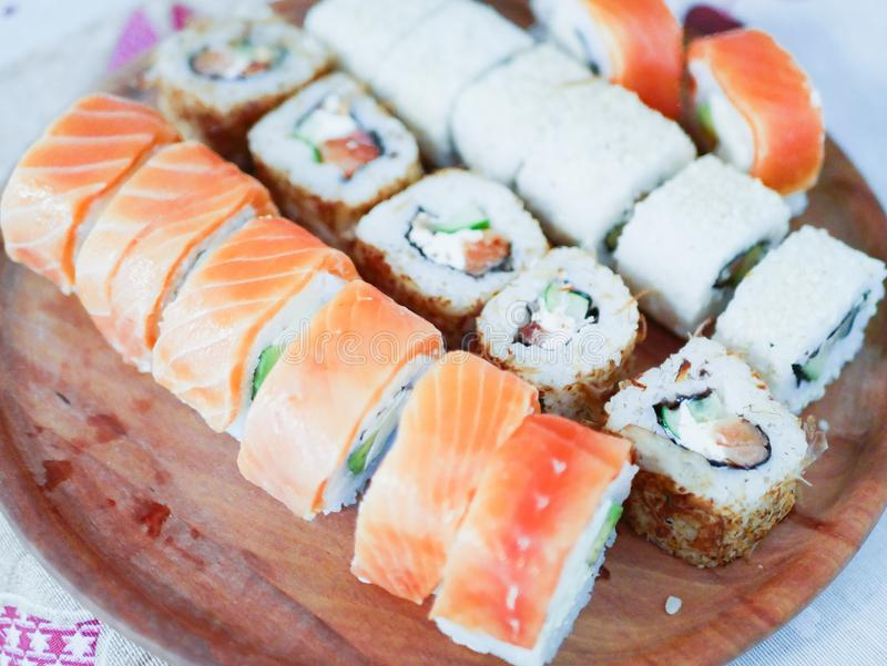 Sushi on a wooden plate. Sushi Set nigiri, rolls and sashimi served in wooden round tray stock photo