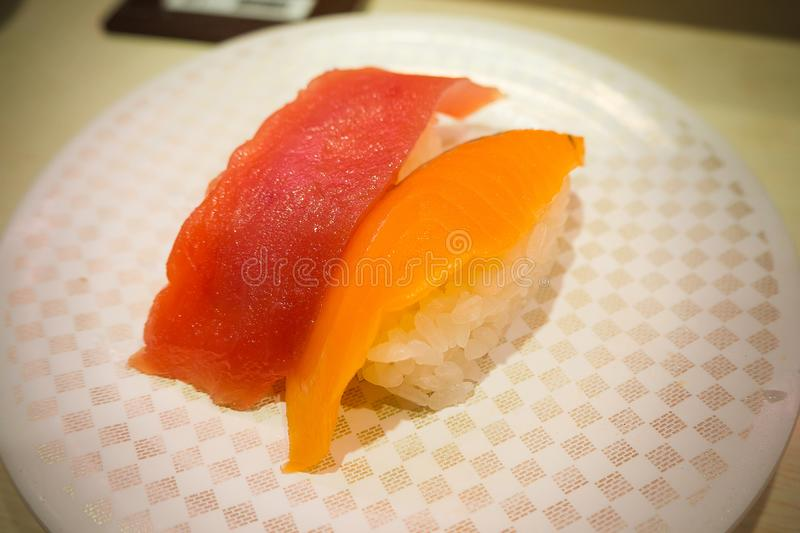 The sushi 100 yen on white Plate in Japanese restaurant in Tokyo royalty free stock images
