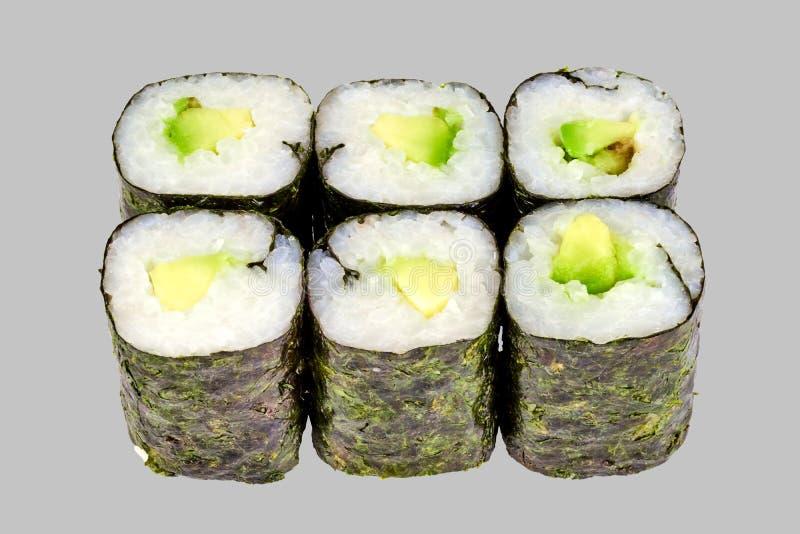 sushimakirulle med avokadot på en grå bakgrund arkivbilder
