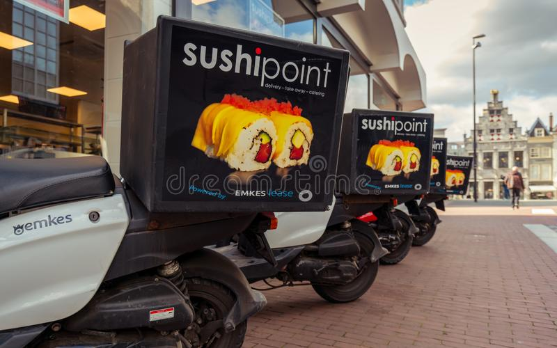 SushiPoint scooters in a row stock image