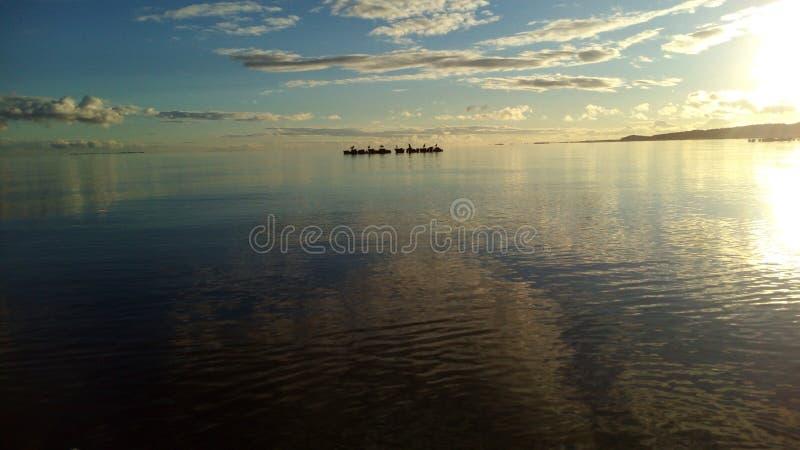 Susnset di calma della natura del lago del mare del cielo fotografia stock
