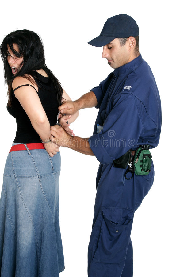 Suspect thief being handcuffed. Suspect female being handcuffed by an officer stock photo