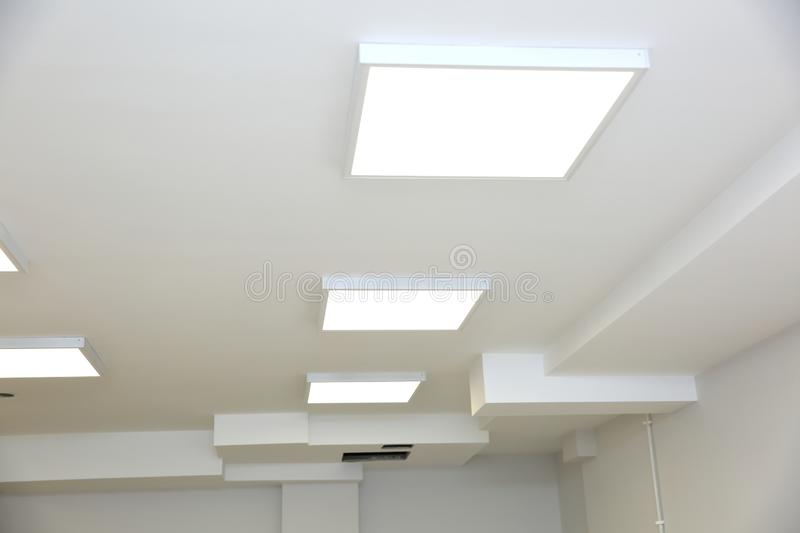 Suspended ceiling with modern LED lighting. royalty free stock photography