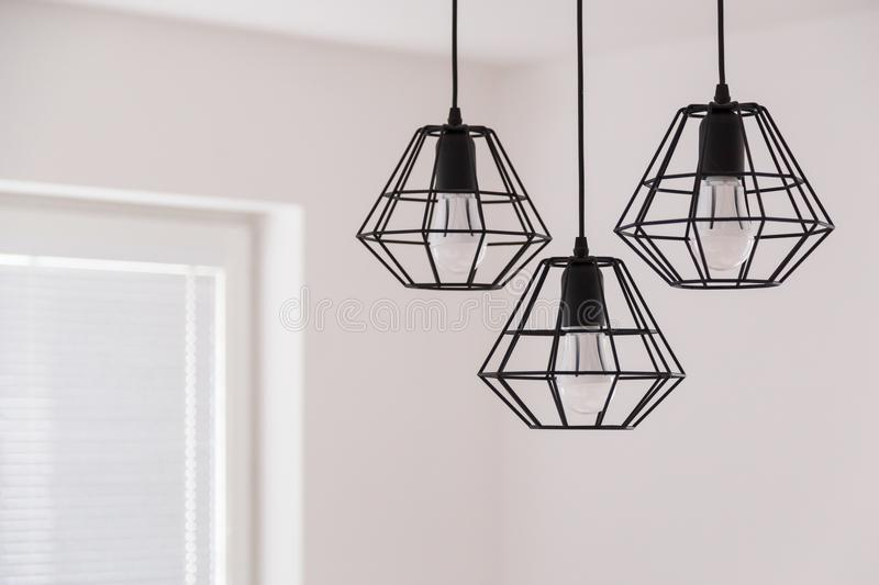 Suspended chandelier in loft style in a modern house interior. royalty free stock photos