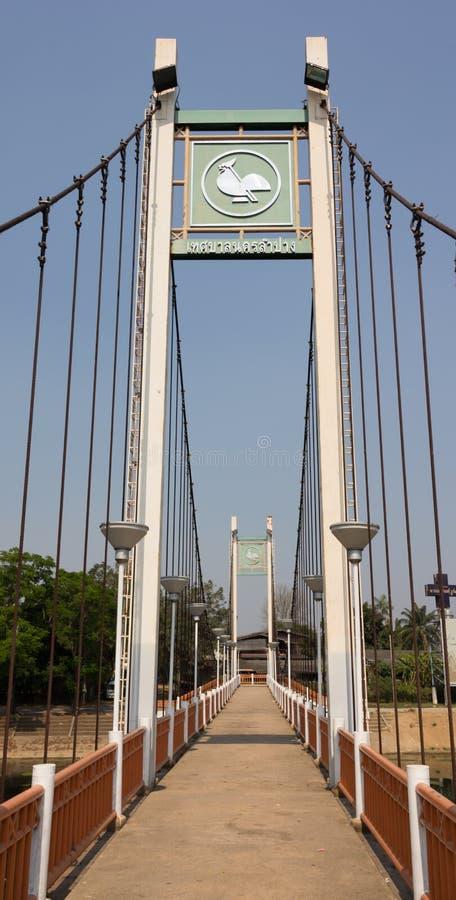 Suspension bridge above river wang Lampang, Thailand stock photography