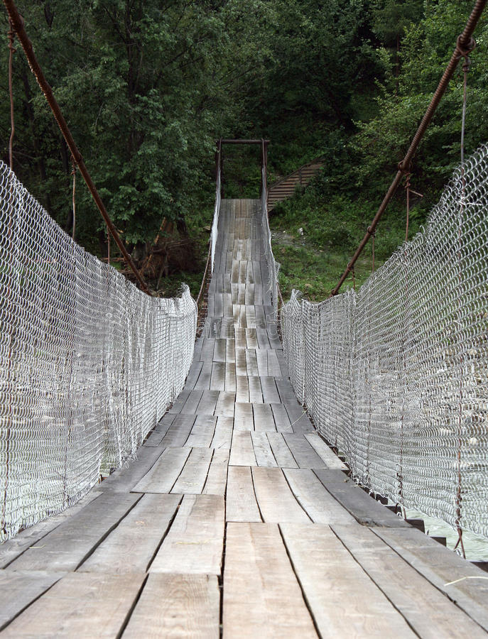 Suspension Bridge Across Mountain River Royalty Free Stock Images