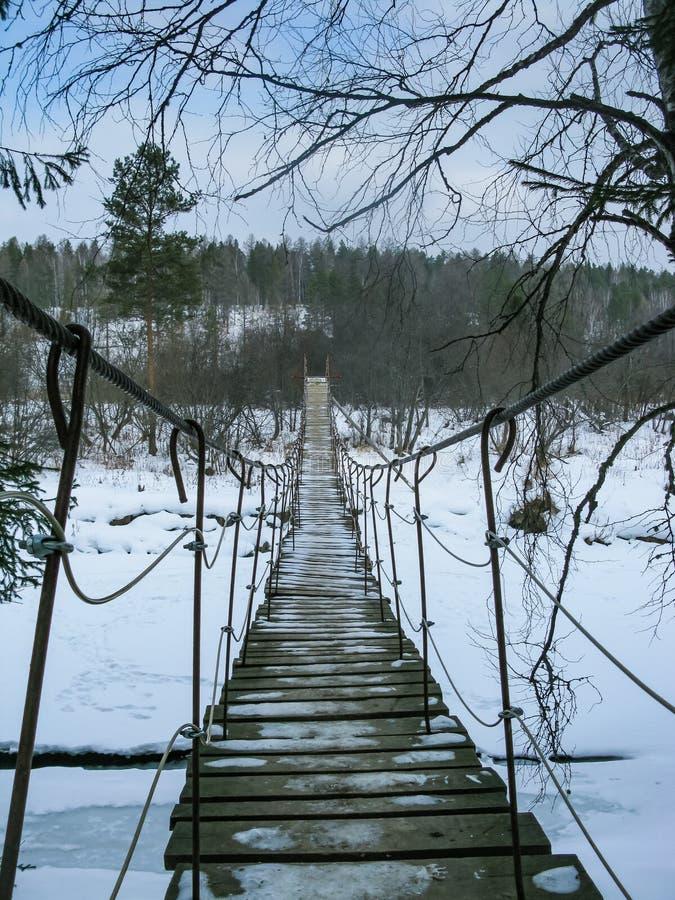Suspension bridge across the river in the natural park Olenyi brooks in the Sverdlovsk region royalty free stock photos