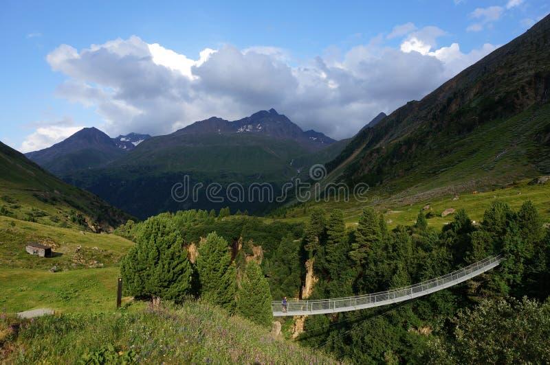 Suspension bridge across the Rofnerache river. Vent, Oetztal. Austria. royalty free stock photos