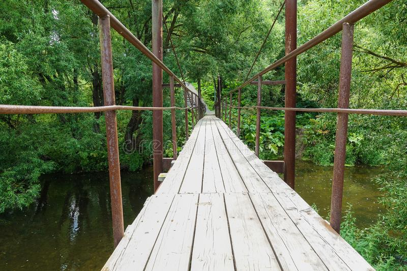 Suspension bridge, Crossing the river, ferriage in the woods.  royalty free stock photography