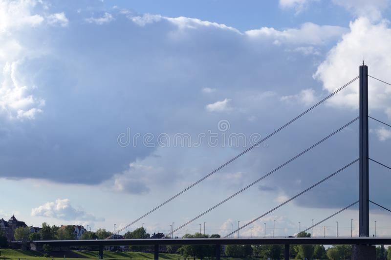 Suspension bridge crossing the river rhine in dusseldorf, germany stock image