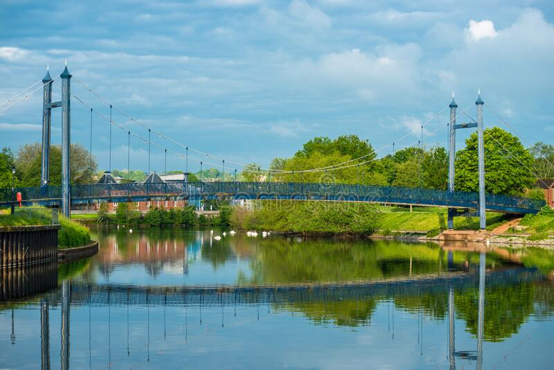 Suspension bridge at Exeter Quay. Or Quayside in early morning light. Devon, England, UK stock image
