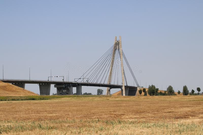 Suspension bridge over river IJssel at Kampen named Eilandbrug in the Netherlands. royalty free stock photo