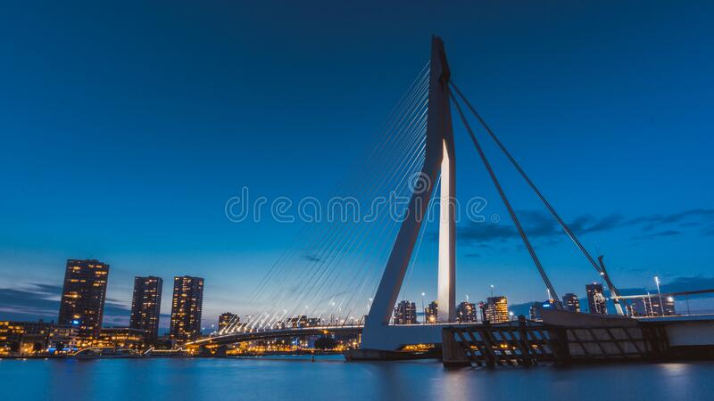 Suspension bridge over river at twilight royalty free stock images