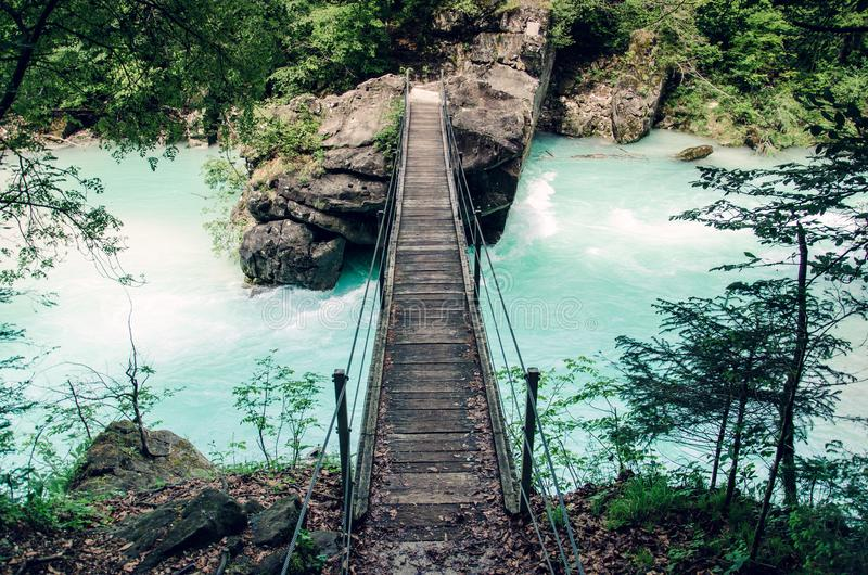 Suspension bridge over Soca river, popular outdoor destination, Soca Valley, Slovenia, Europe royalty free stock photography