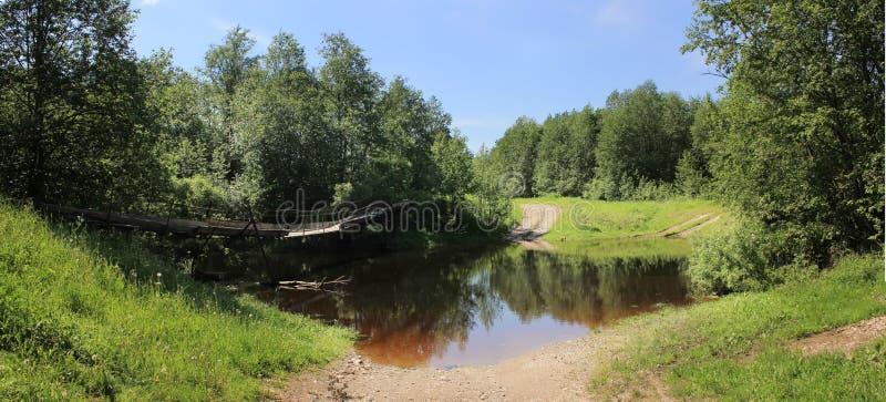 Suspension bridge on the river, Novgorod region, R stock photos