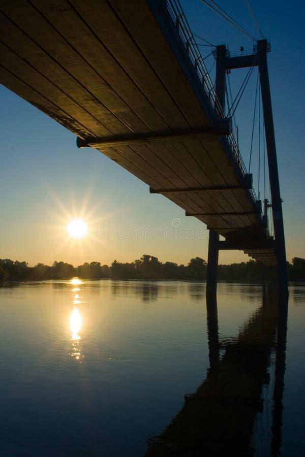 Suspension bridge in sunrise stock photo