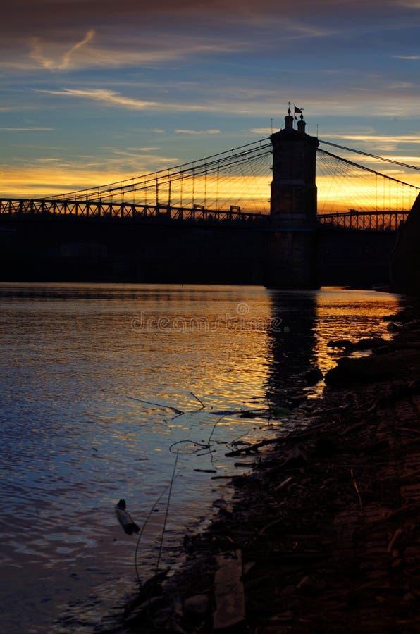 Suspension Bridge at sunset, Cincinnati Ohio. The John A. Roebling Suspension crosses the Ohio River in downtown Cincinnati, Ohio. Colorful image taken at sunset royalty free stock images