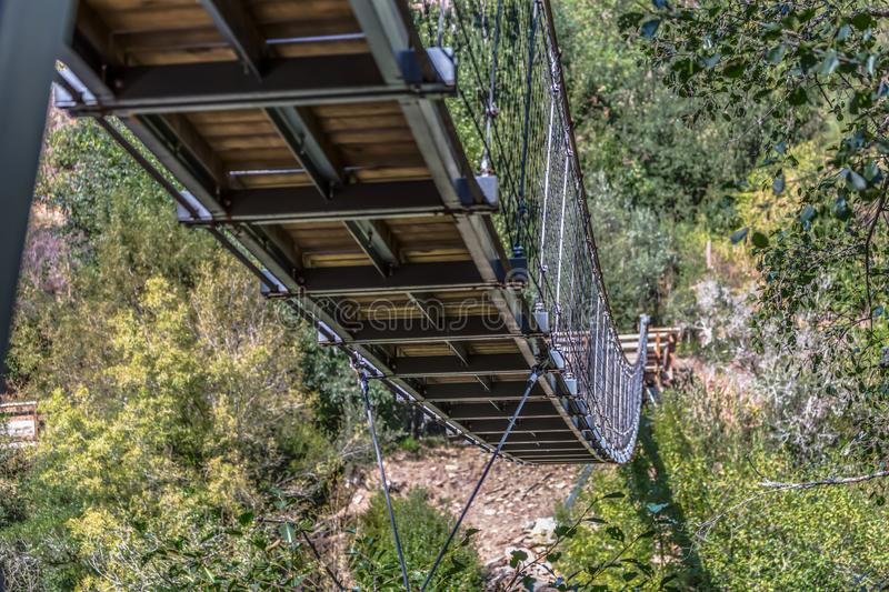 Suspension bridge view on pedestrian walkway on mountains royalty free stock photography