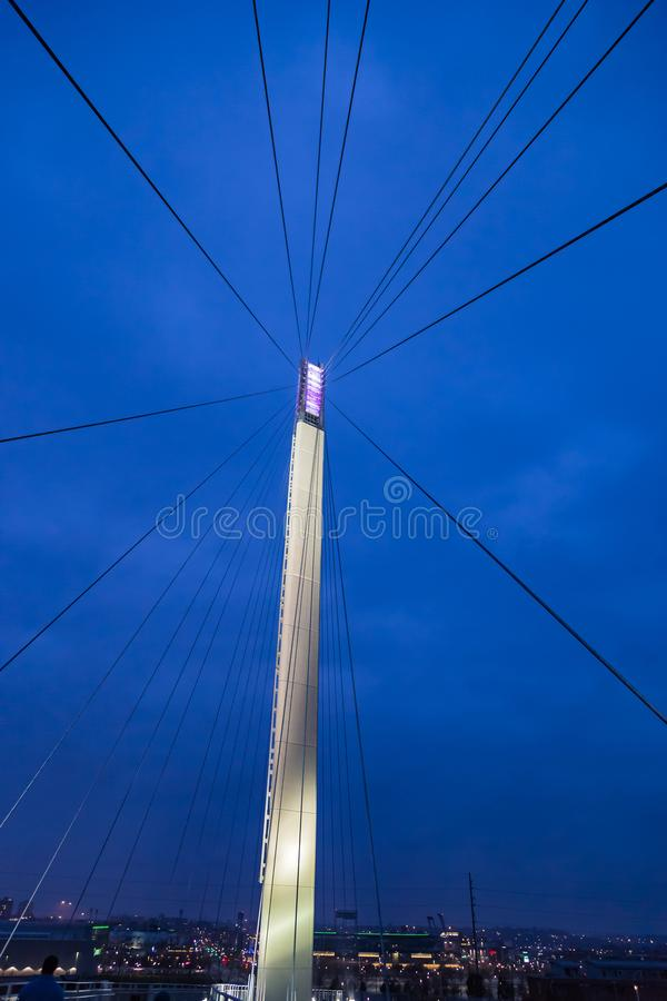 Suspension bridge wires hanging from the pole. The wires of the Bob Kerrey suspension foot bridge on the Missouri river in Omaha as they emanate from the pole stock images